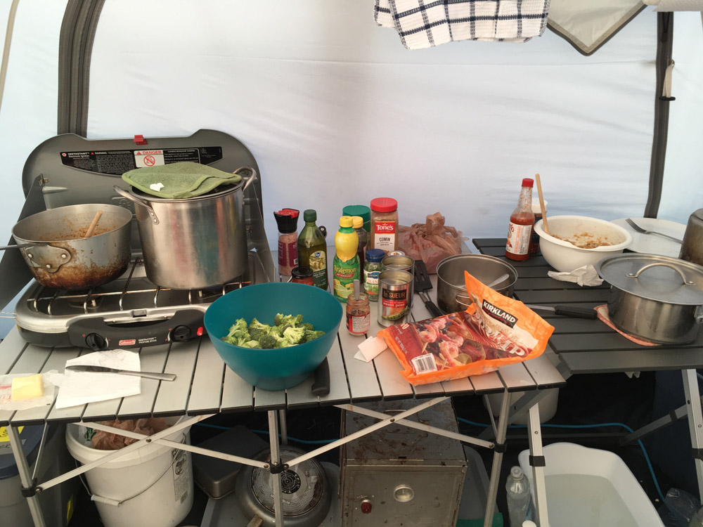 Metta prepares to make a shrimp curry for dinner in our camp kitchen. Photo: Metta McGarvey