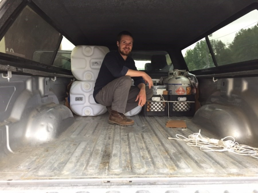 Ethan ties off the AV gas and propane containers for the long drive up the haul road.