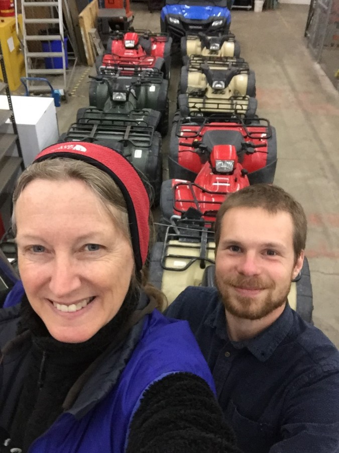 Ethan and Metta celebrate the end of the warehouse work with a selfie in front of some other program's fleet of ATVs. Do you think they'd miss one?