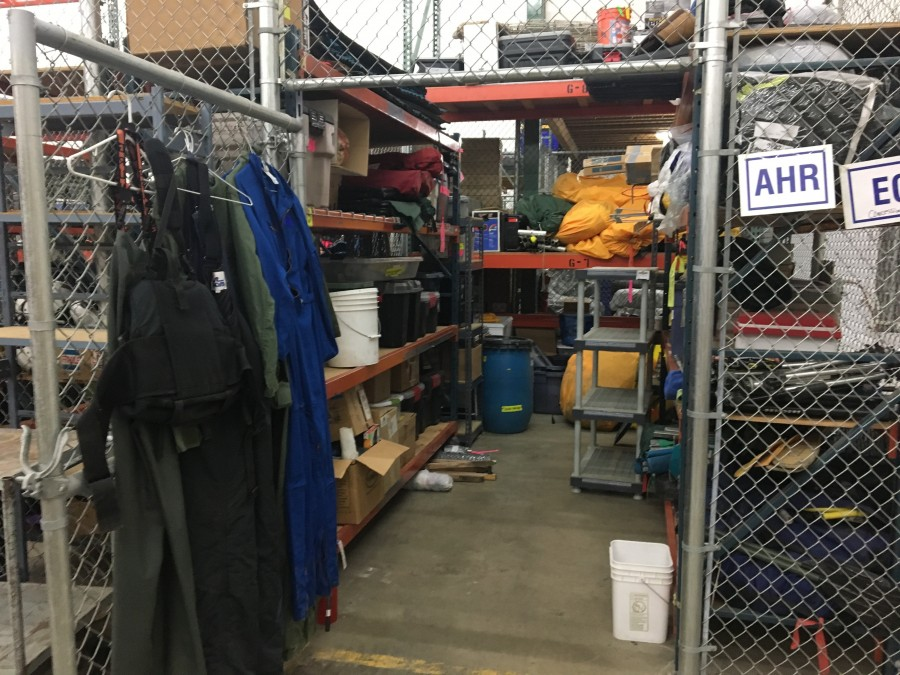 We spend weeks among the dusty shelves of the Anchorage warehouse, seen from high on a ladder in this cavernous, unheated space.