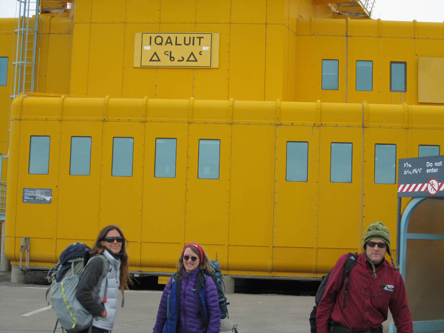 Brad, Sage, and Metta on the tarmac entering the Iqaluit airport, happy to finally be starting our next adventure.