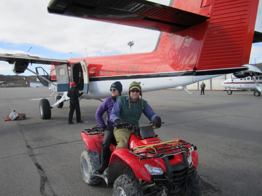 "Back in ""civilization"", we unloaded the ATV and got ready to sort and pack all of our gear for the trip home.  Here, Metta and Brad head out to drive in style on the city streets of Iqaluit to the warehouse where all the gear gets stored."