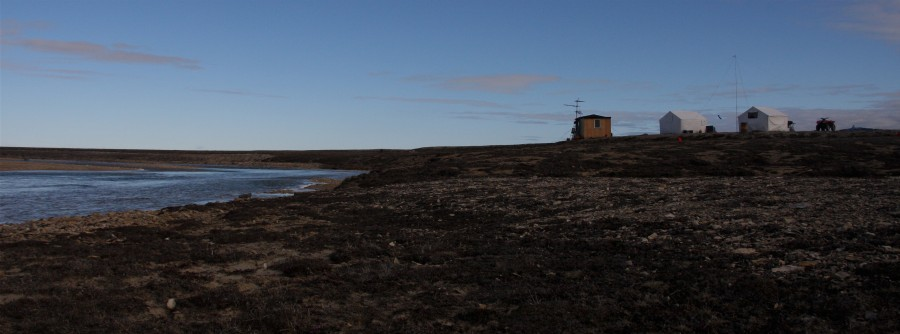 The Coats Island shorebird camp is perched on the edge of a meltwater river.