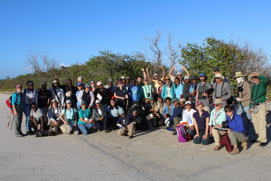The workshop group in the field with their collected trash after the beach-clean up exercise.