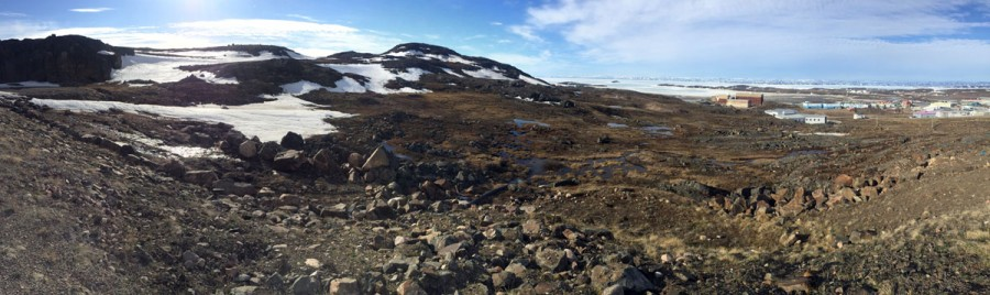 The landscape around Iqaluit is steep and rocky, with beautiful views of Frobisher Bay and the mountains of Baffin Island in the distance.