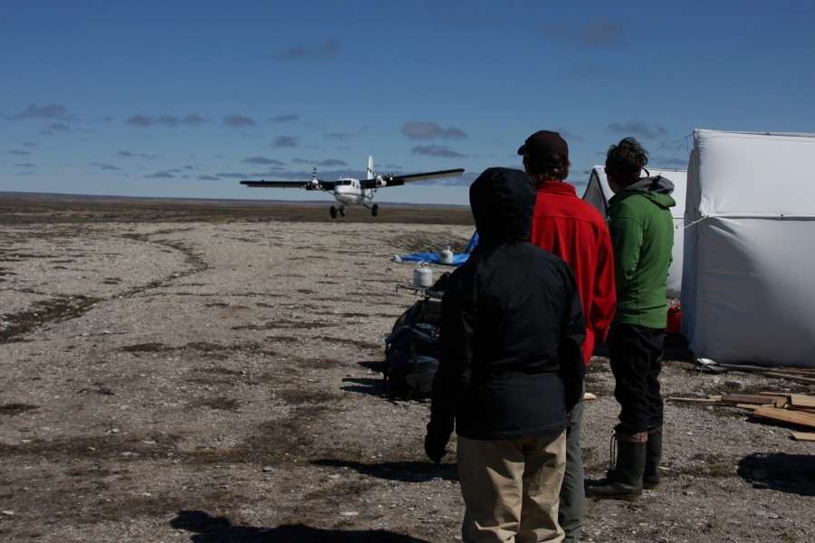 The Coats Island shorebird crew watches the Twin Otter touch on the gravel esker that serves as a runway next to camp