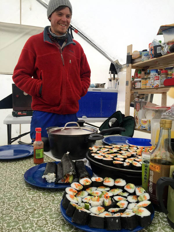 Malkolm Boothroyd prepared an epic cooked sushi feast during a stretch of bad weather. He brought in the key ingredients in his personal luggage to make it a surprise.
