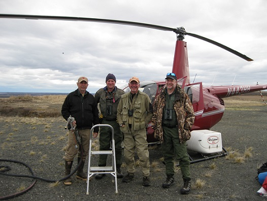 The team getting ready to jump into the helicopter to start another day of surveying.  Left to right are: Stan Hermens our pilot, Brad Winn, Bob Gill, and Stephen Brown.