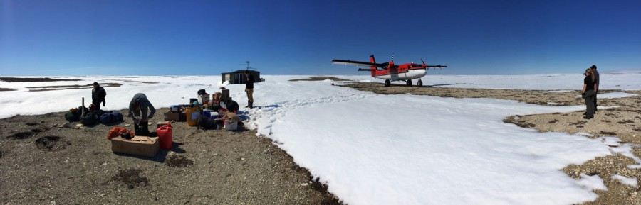 The crew arrives on Coats Island and starts to set up as the pilots survey the runway before takeoff.