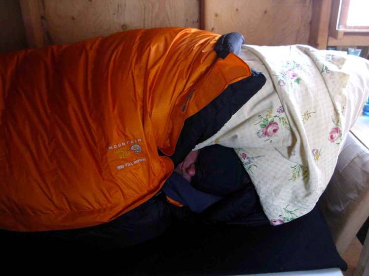 Our down bags keep us warm at night, inside our tiny cabin.  Metta McGarvey sleeps soundly while outside the winds howl, and the birds stay warm with only their feathers.