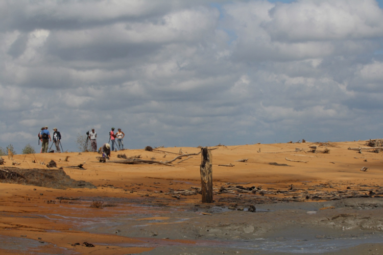 Standing on the sand dune between the now-flooded rice fields and the Atlantic Ocean, forum participants survey the area.